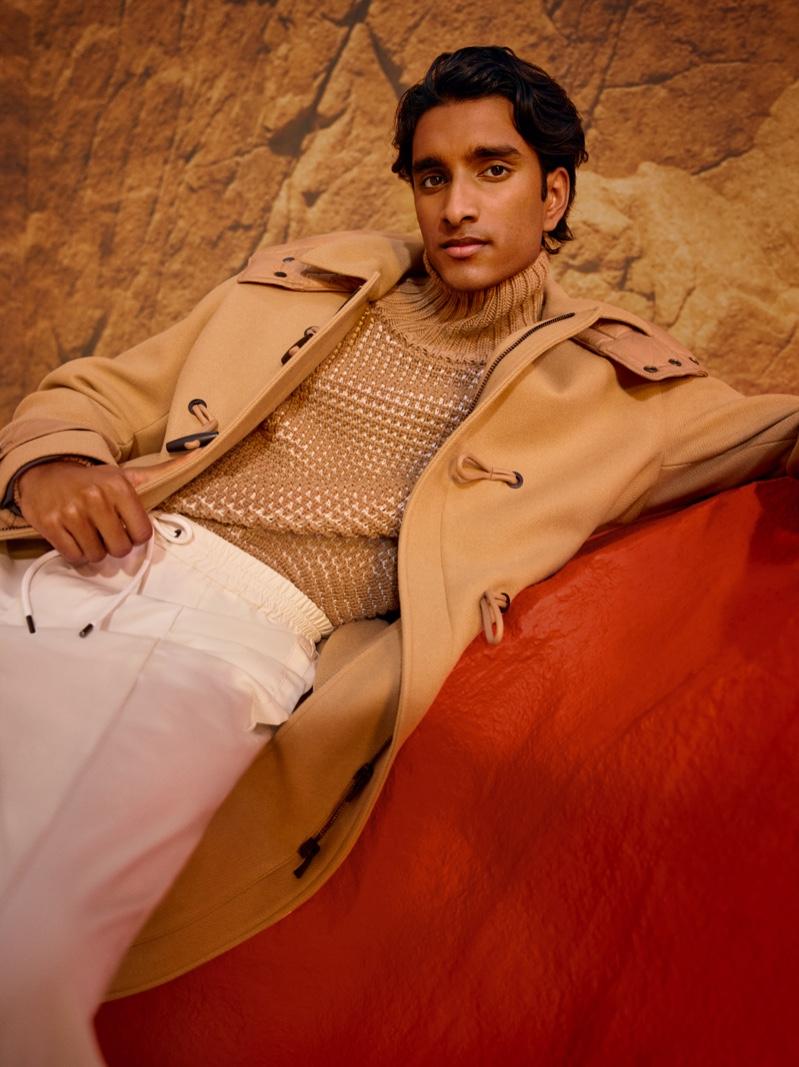 A striking vision in camel, Jeenu Mahadevan sports a dufflecoat for BOSS's fall-winter 2021 men's campaign.
