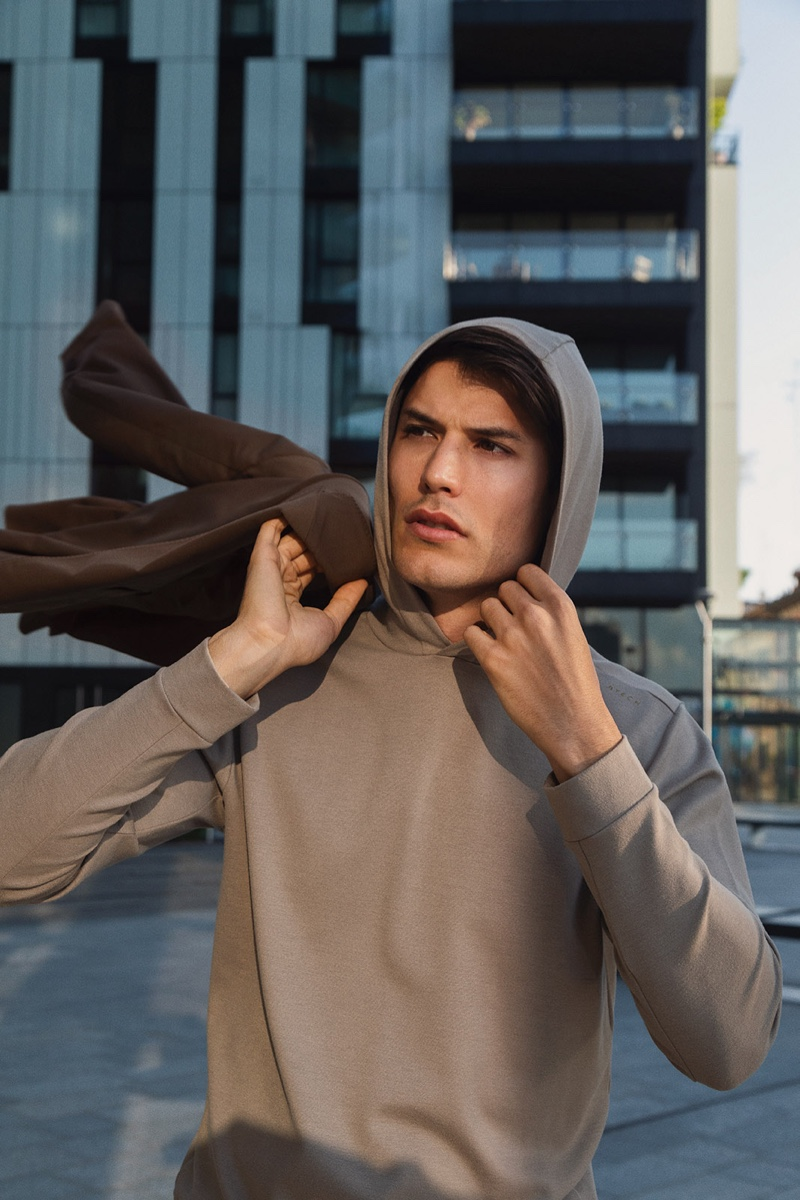 Spanish model Emilio Flores sports a hooded pullover by Boggi Milano.