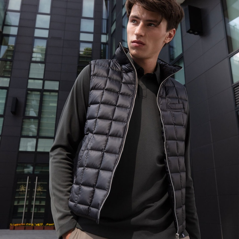 Clement Deheunynck wears a quilted vest over a long-sleeve polo from Boggi Milano.
