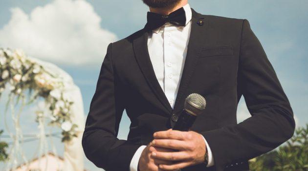 Cropped Groom Tuxedo Microphone Speech
