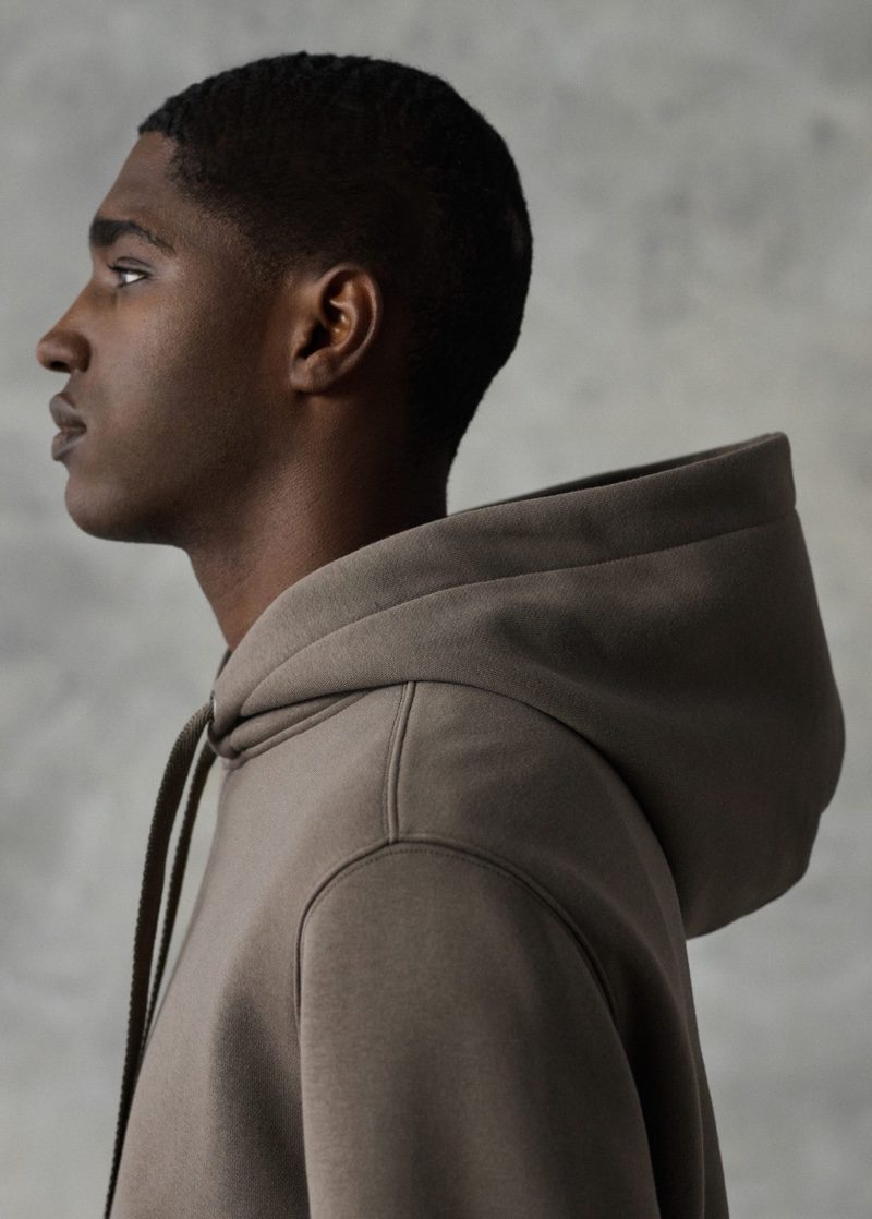 Delivering a side profile, Diogo Gomes sports a Mango hoodie cotton sweatshirt.