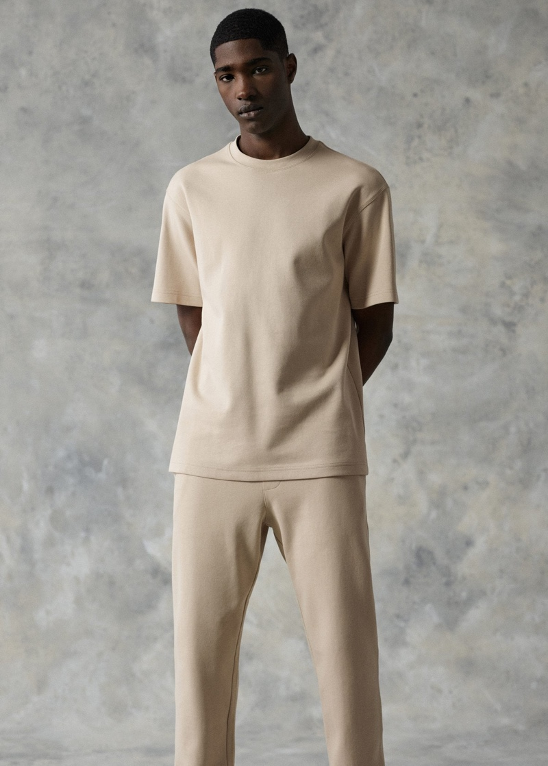 Front and center, Diogo Gomes sports a Mango plain cotton t-shirt with jogger-style trousers.