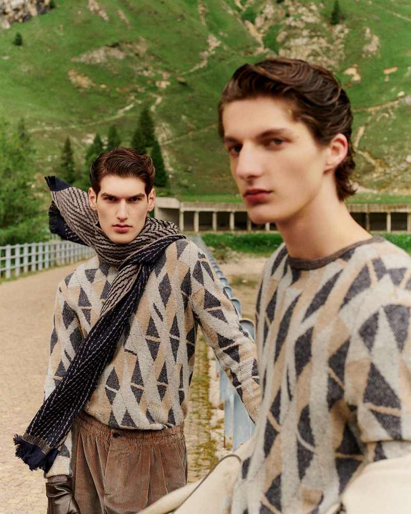 Models Emiliano Marku and Hugo Gillain sport geometric print sweaters from Giorgio Armani.
