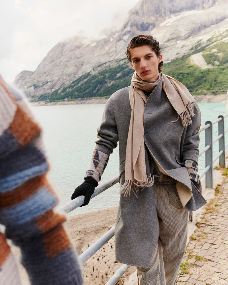 Hugo Gillain is a chic vision as he dons a gray coat and chic layers from Giorgio Armani's fall-winter 2021 men's collection.