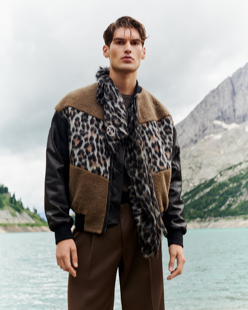 Emiliano Marku makes a bold statement in a leopard print bomber jacket with a matching scarf from Giorgio Armani.