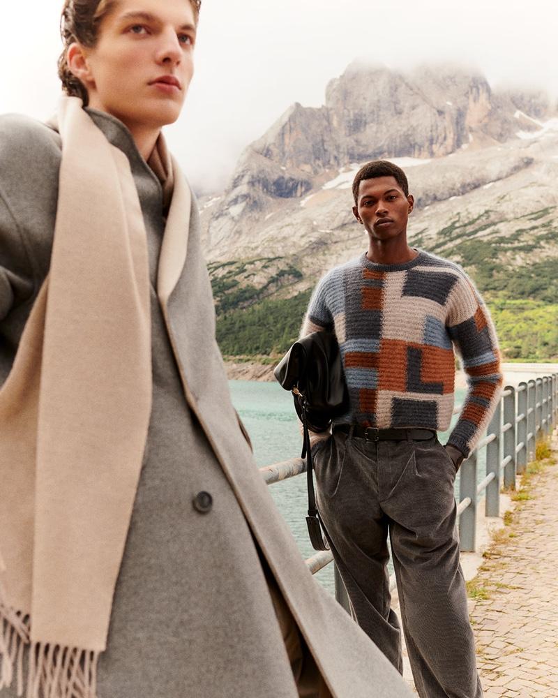 Pictured alongside Hugo Gillain, Fabio Tavares wears a mohair and silk jacquard sweater by Giorgio Armani.