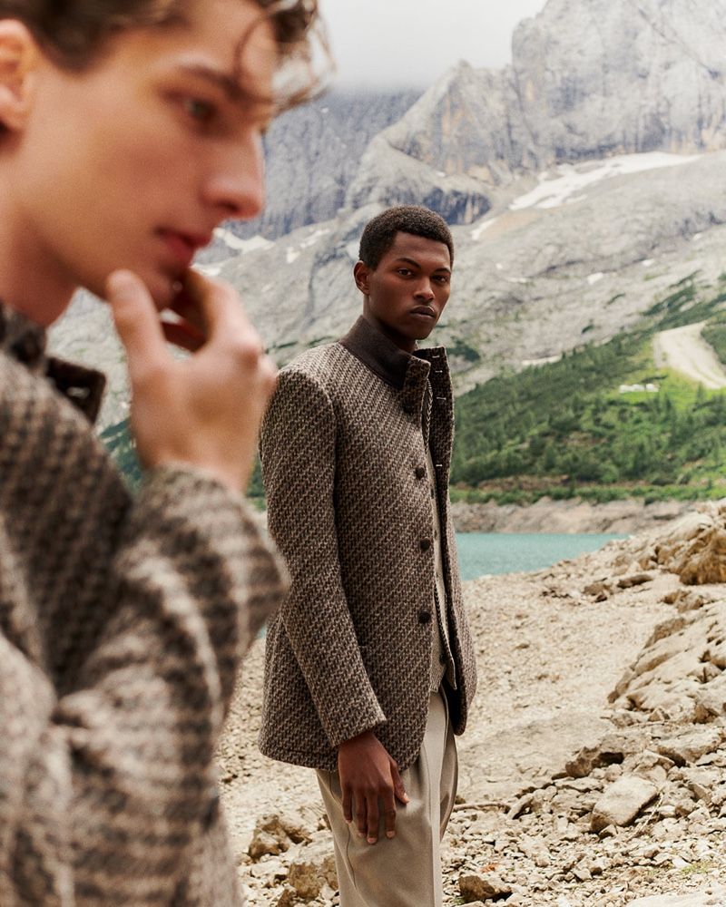 Fabio Tavares dons a tweed jacket with pleated trousers by Giorgio Armani.