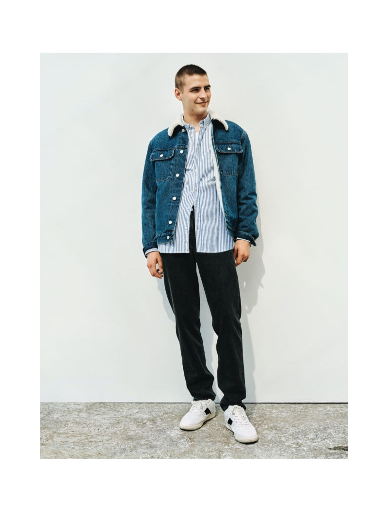 Black is the go-to color as August Testad rocks H&M's relaxed-fit denim jeans with a striped shirt and denim jacket.