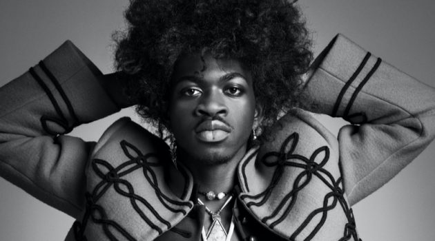 Channeling Jimi Hendrix, Lil Nas X wears a Louis Vuitton jacket with vintage fashions and accessories for VMAN.