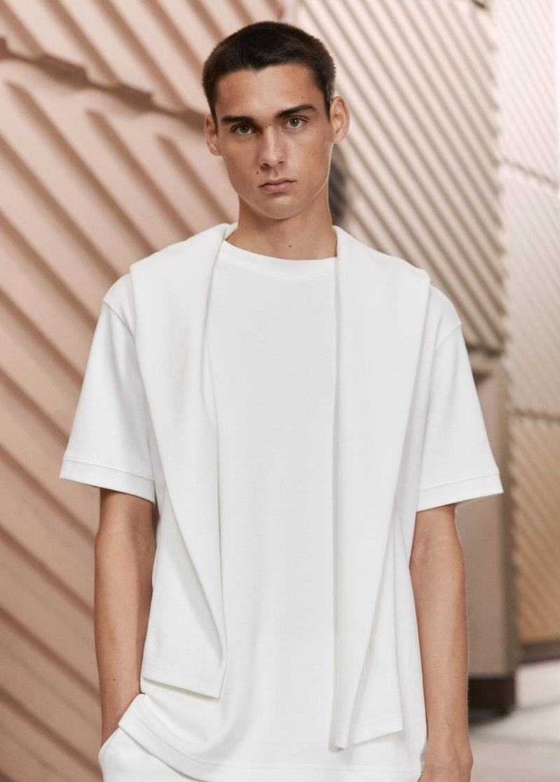 Ludwig Wilsdorff wears a Mango Man structured relaxed-fit t-shirt with a cotton sweatshirt draped over his shoulders.