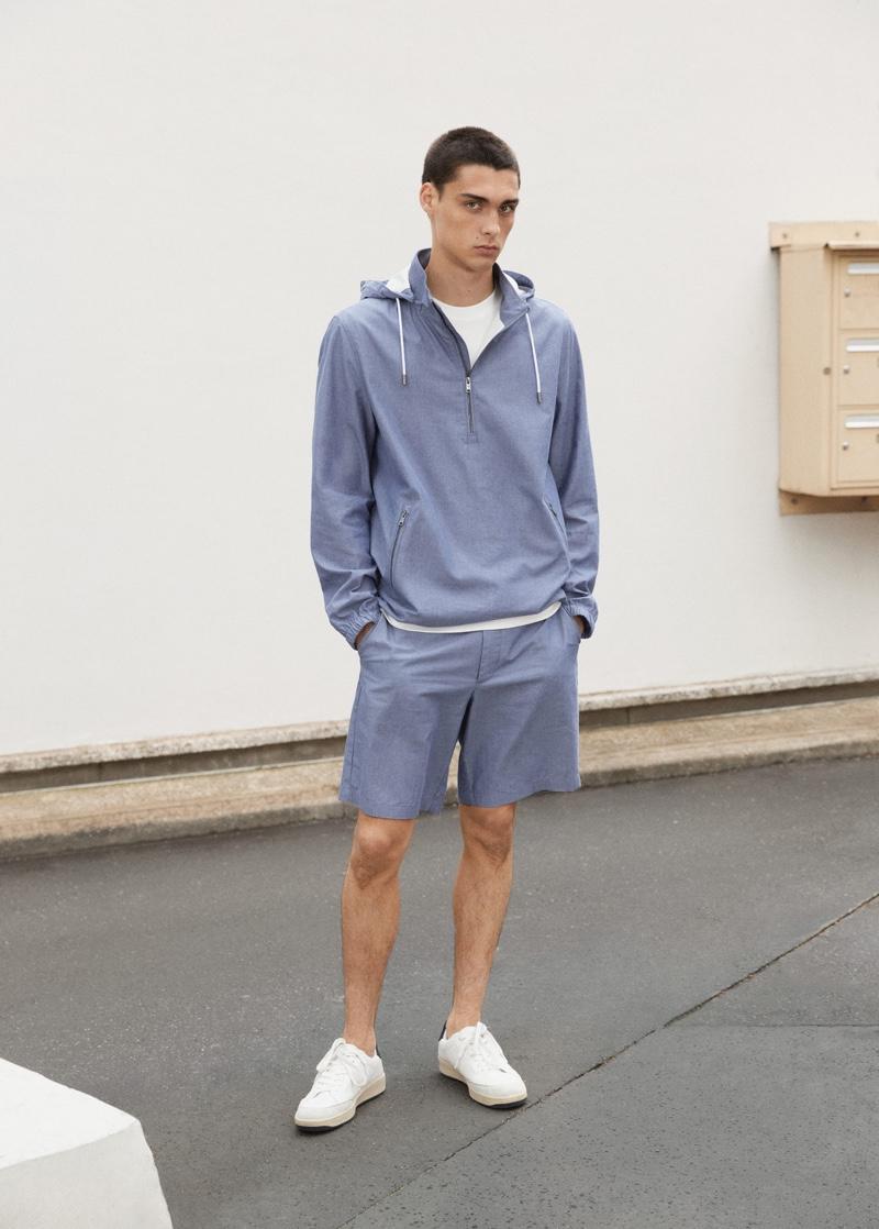 Showcasing CO-ORD style, Ludwig Wilsdorff wears a Mango Man cotton jacket with chino-style Bermuda shorts.