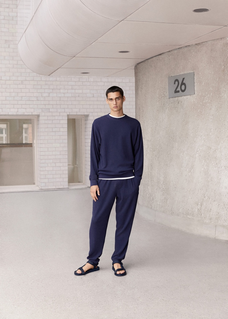 Front and center, Ludwig Wilsdorff makes a case for leisure in Mango Man's structured cotton sweatshirt and joggers.