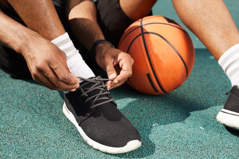 Man Basketball Tying Shoes Socks
