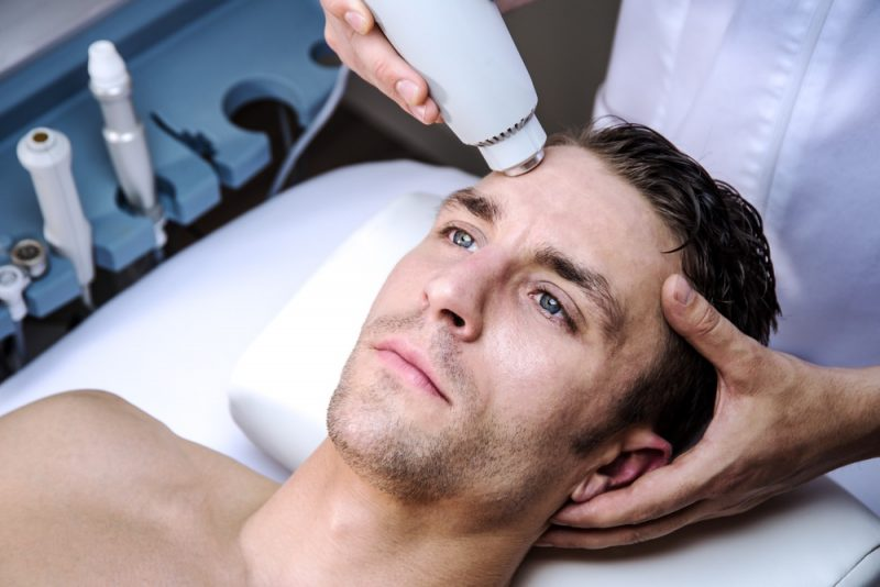 Man Getting Face Treatment