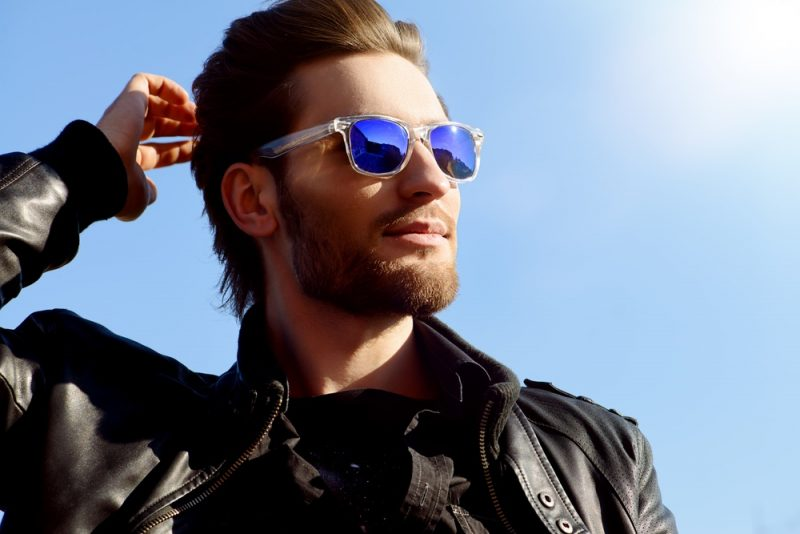 Man Wearing Clear Sunglasses with Blue Lenses
