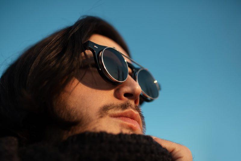 Man Wearing Round Framed Sunglasses