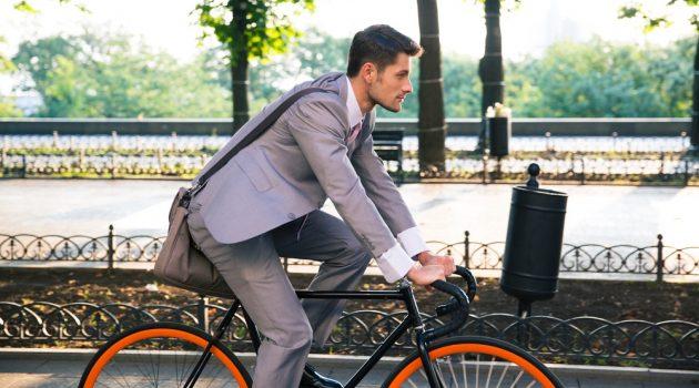 Man in Suit Riding Bike