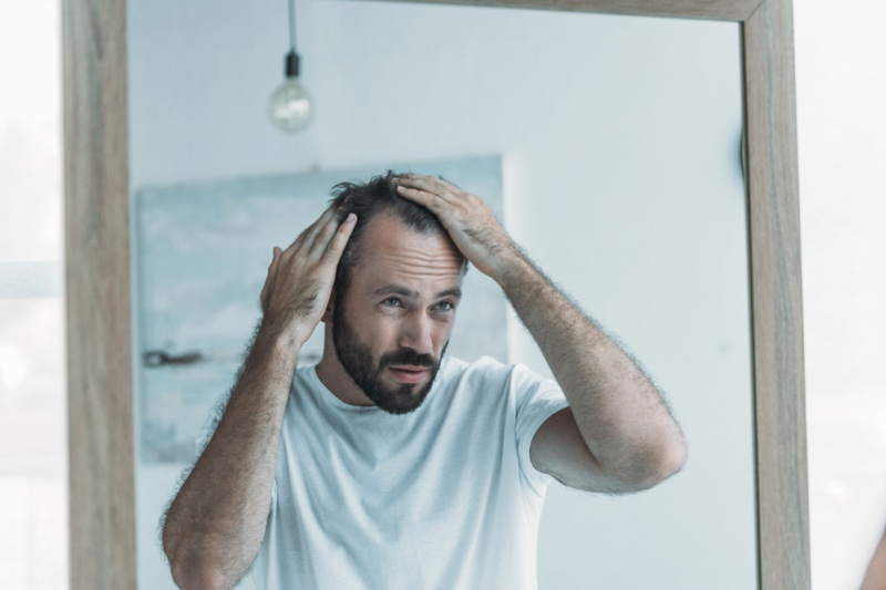Middle Aged Man Looking Balding Hair