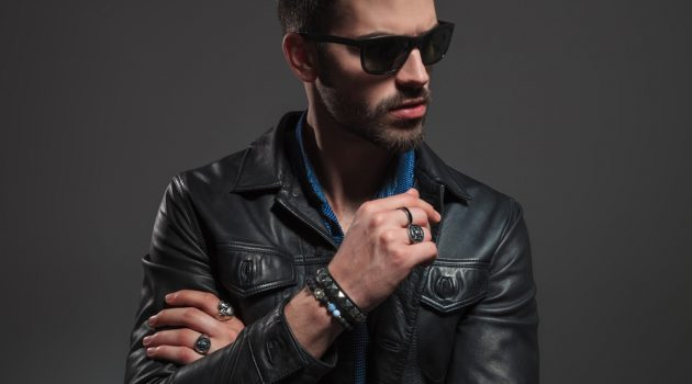 Stylish Man in Leather Jacket Wearing Rings and Bracelets