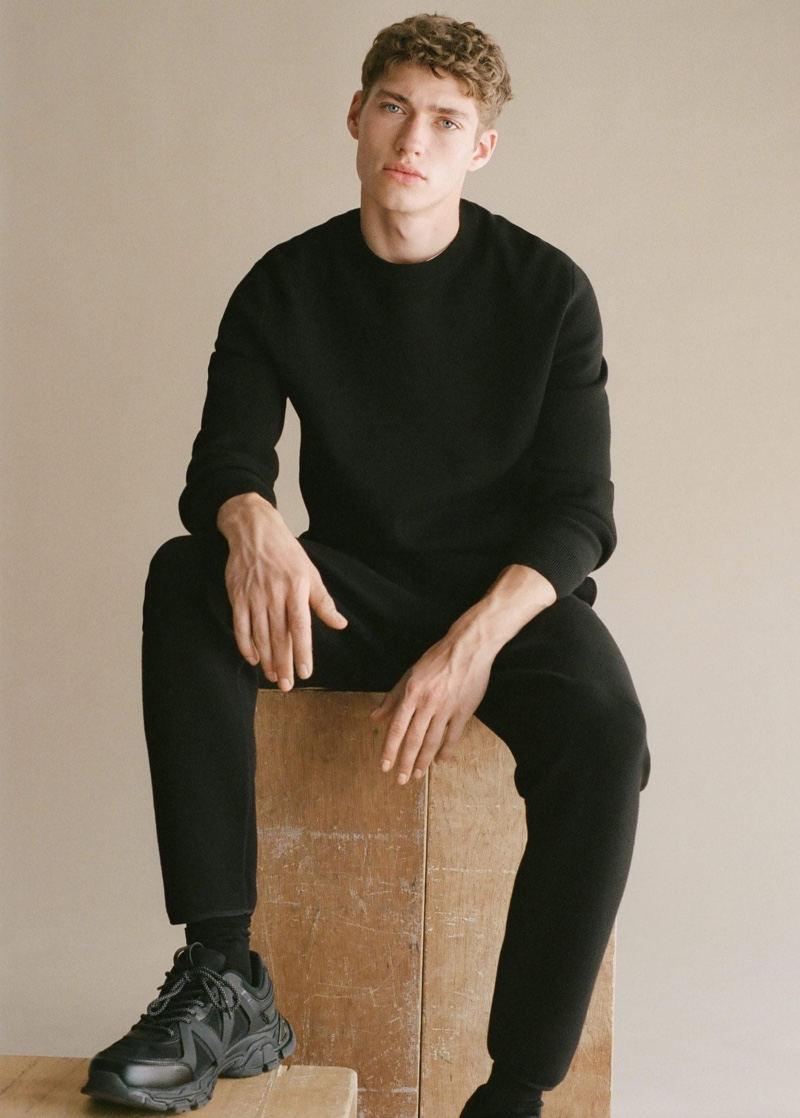 Going casual, Valentin Humbroich wears a Mango Man long sleeve piqué t-shirt with stretch knit joggers and track sole sneakers.