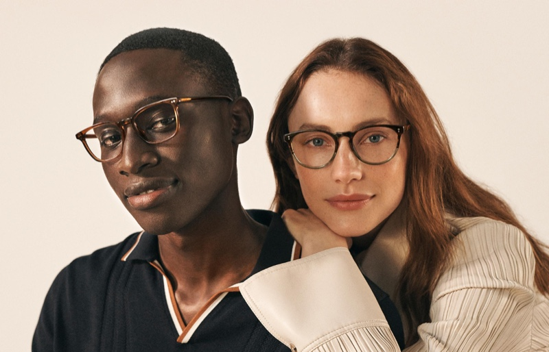 Pictured left, Baba Diop dons Warby Parker's Elias glasses in Cacao Crystal.