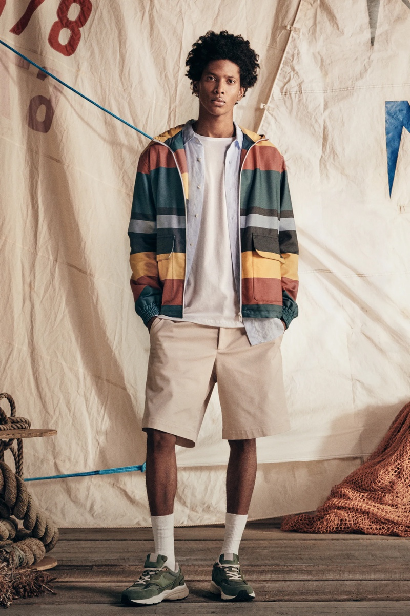 Showcasing casual style, Rafael Mieses wears a hooded striped jacket with shirting and shorts from Zara.