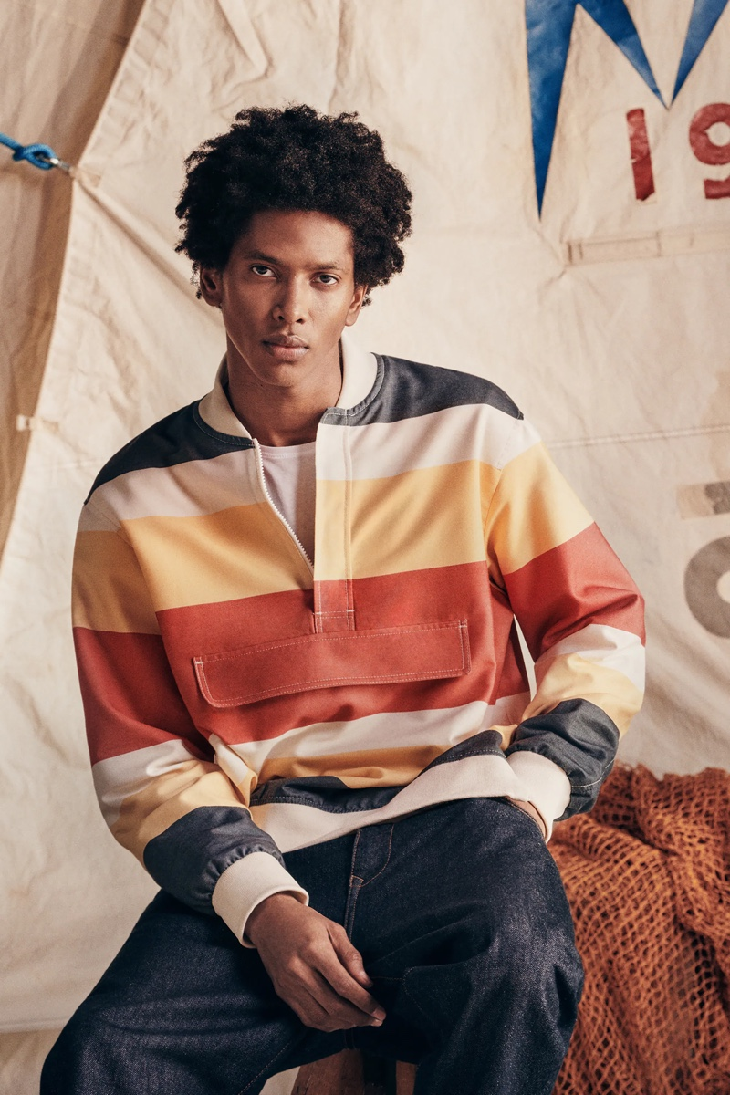 Front and center, Rafael Mieses sports a Zara striped jacket with dark wash denim jeans.