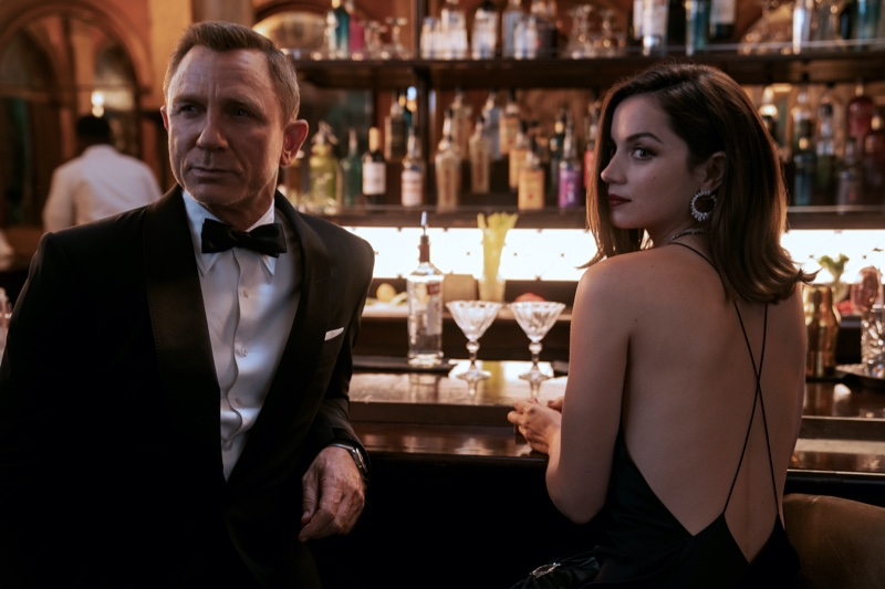 """Donning a Tom Ford tuxedo as James Bond, Daniel Craig joins Paloma, played by Ana de Armas in """"No Time to Die."""""""