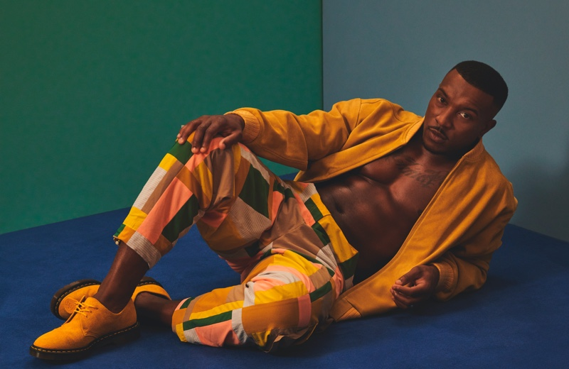 Hitting the studio for Hunger magazine, Ashley Walters wears a Lavin's Vintage Clothing jacket with KA Wakey pants and Dr Martens shoes.
