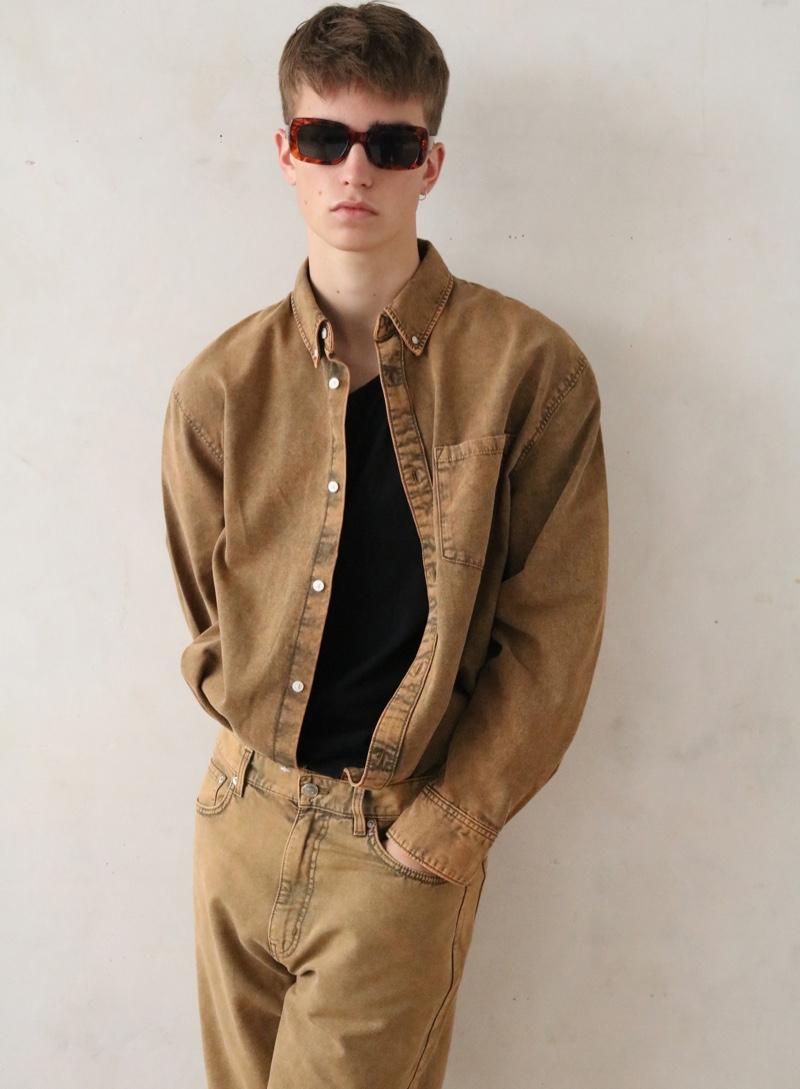 Ben wears sunglasses Saint Laurent, shirt Acne Studios, jeans and shirt Weekday.