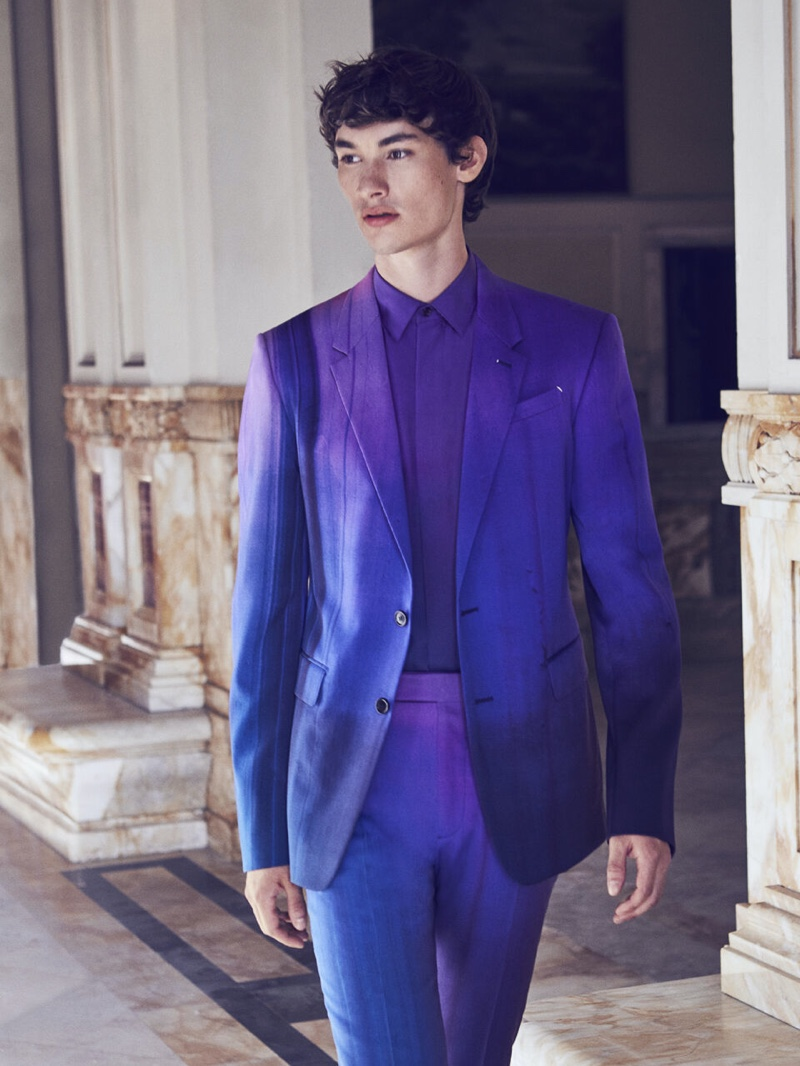 Dylan Li Lagain wears a stunning purple suit with a silk shirt for Berluti's fall-winter 2021 campaign.