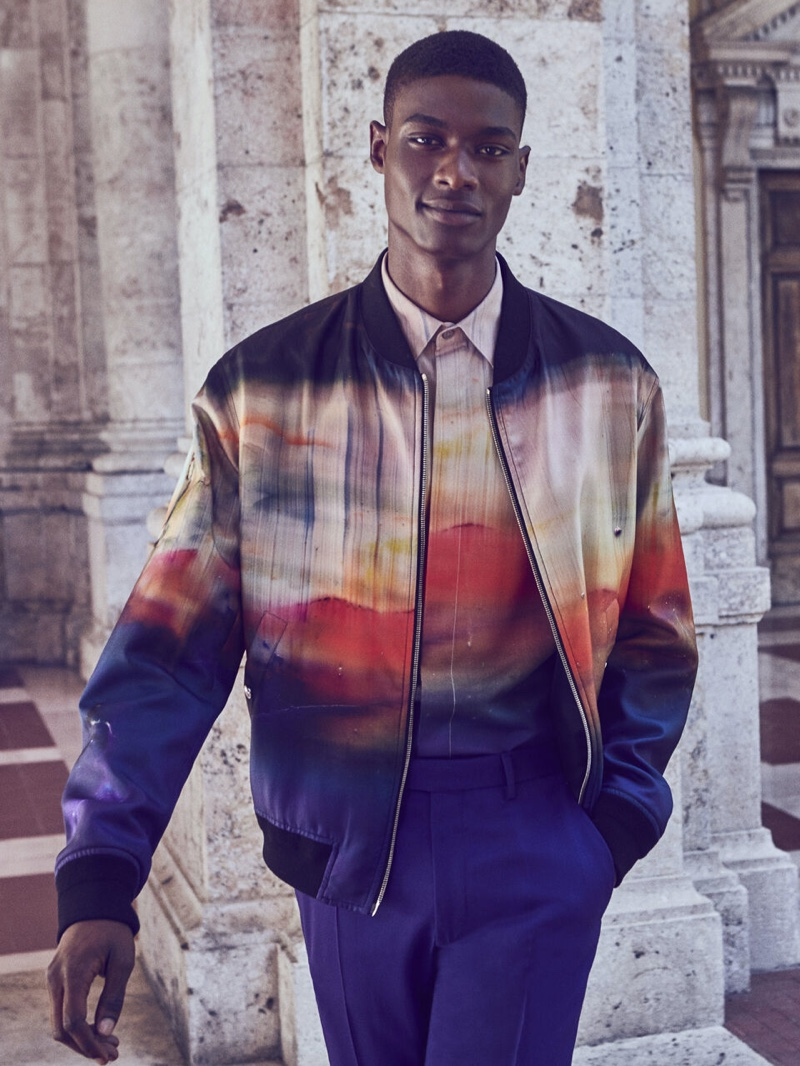 Rachide Embaló wears a matching bomber jacket and shirt for Berluti's fall-winter 2021 campaign.