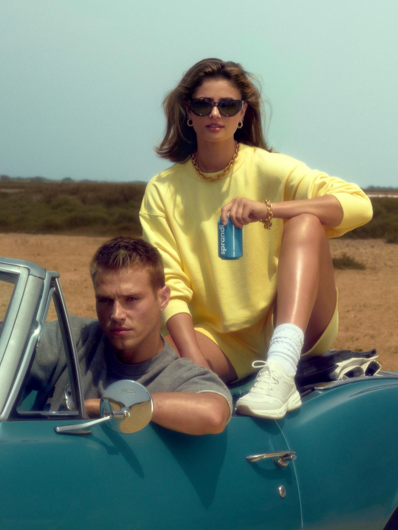 Getting behind the wheels of a vintage car, Matthew Noszka poses with Taylor Hill for CCC Sprandi's fall 2021 campaign.