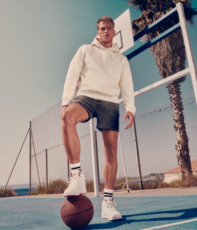 Rocking the brand's white sneakers, Matthew Noszka stars in CCC Sprandi's fall 2021 campaign.