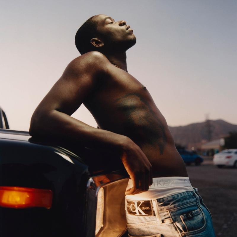 Damson Idris appears in Calvin Klein's fall 2021 men's denim campaign.