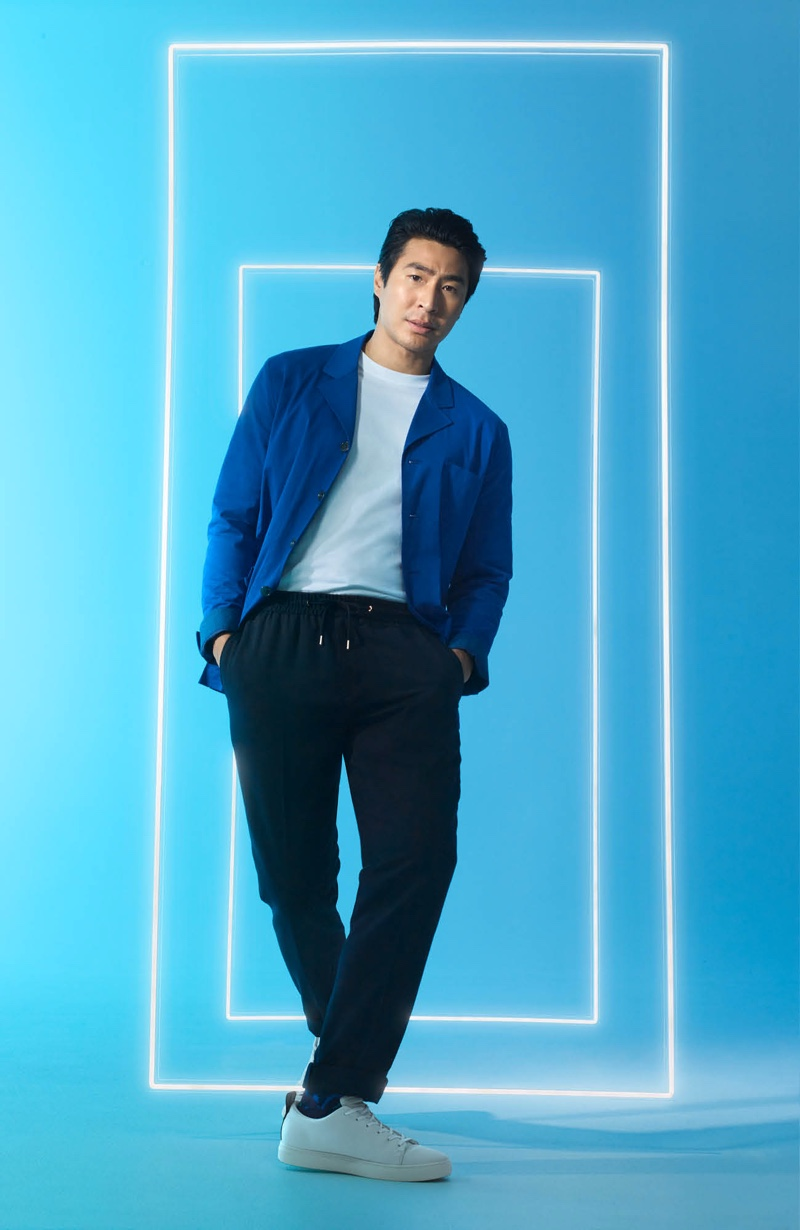 Playing it smart-casual, Chris Pang wears a blue and black leisure look from David Jones.