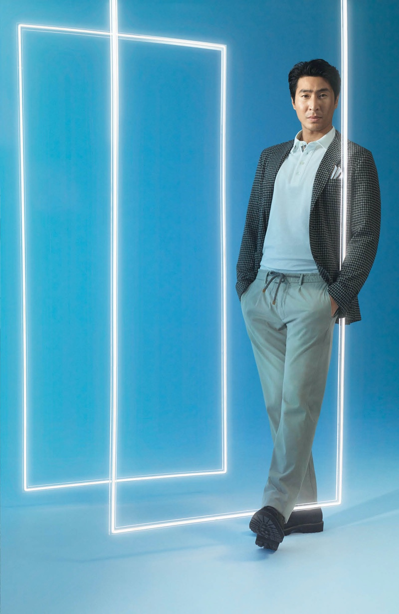 Mixing and matching styles from David Jones, Chris Pang is pictured in a blazer with casual pants that feature an elasticated waist.