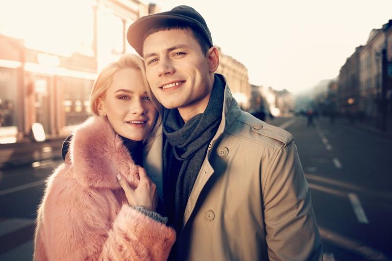 Couple Woman Pink Fur Coat Man Tan Coat