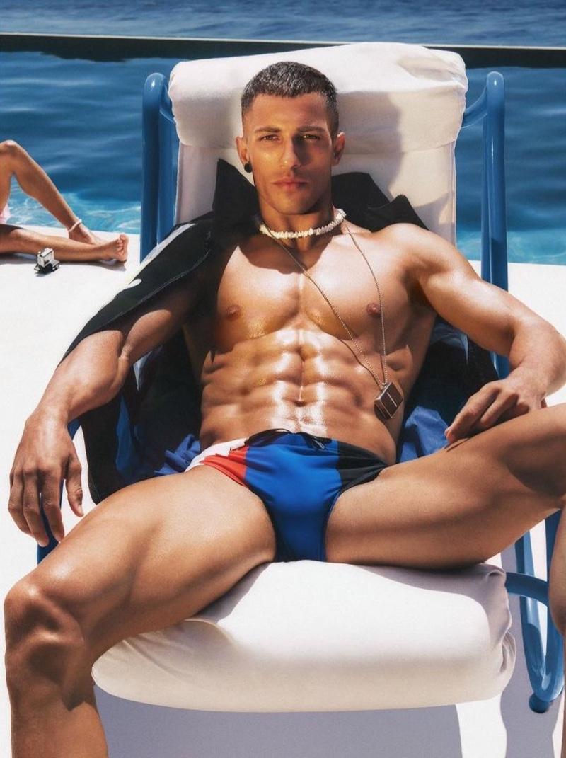 Greek model Christos Katsavochristos fronts Dsquared2's beachwear campaign.