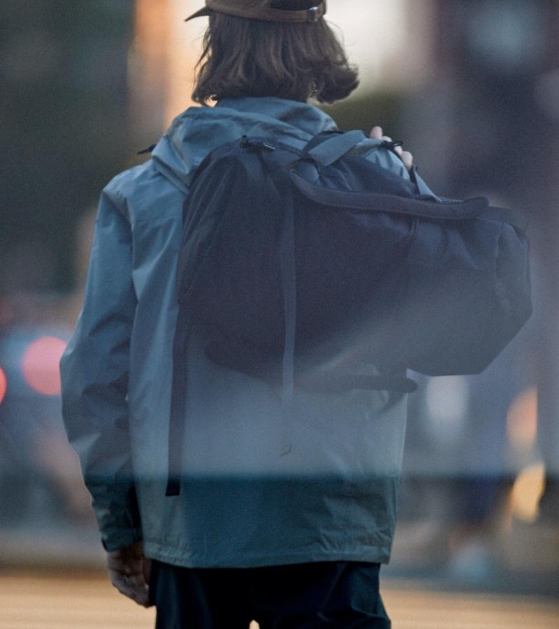 The city traveler, Fredrik Berselius shows off H&M's Multifunctional bag.