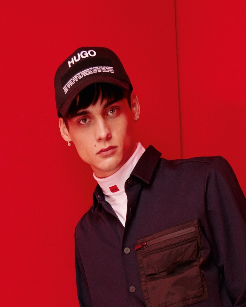 Ludwig Wilsdorff sports a HUGO Manifesto logo cap with more branded fashions from the label's fall-winter 2021 collection.
