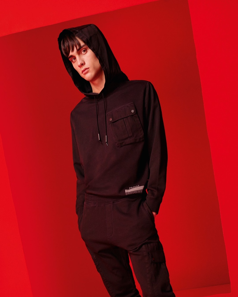 Model Ludwig Wilsdorff goes sporty casual in leisurewear that boasts minimal HUGO logos.