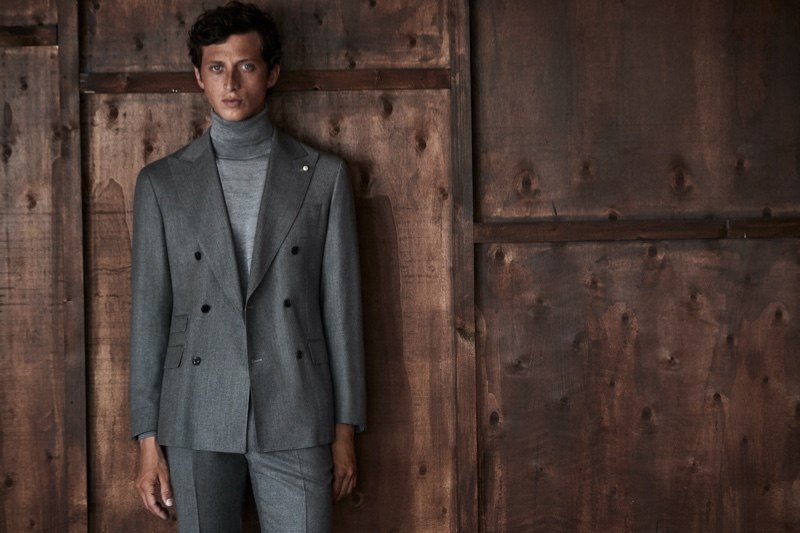 The face of Luigi Bianchi Mantova for fall, Alexis Maçon-Dauxerre makes a case for gray in a sleek double-breasted suit and knit turtleneck.