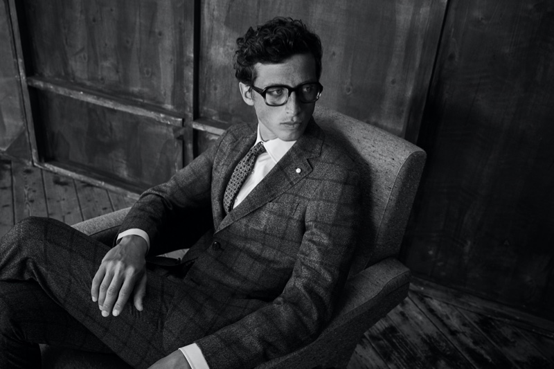 Model Alexis Maçon-Dauxerre sports a windowpane print suit from Luigi Bianchi Mantova's fall-winter 2021 collection.