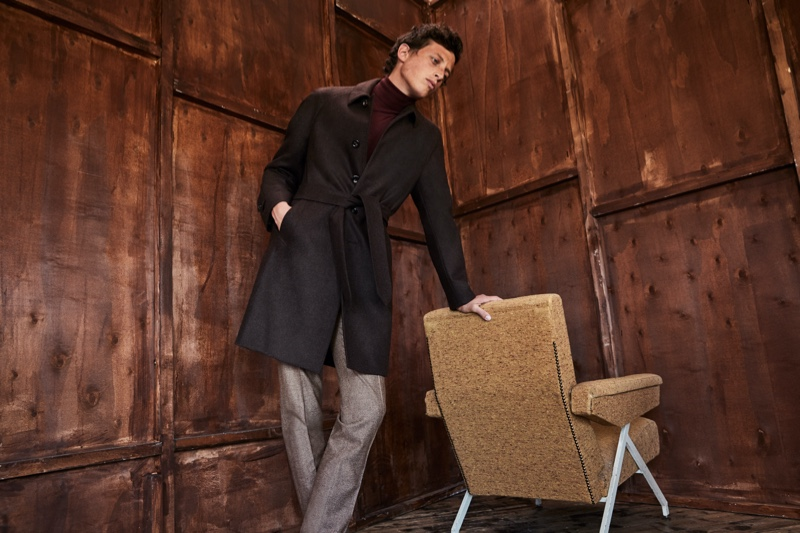 A chic vision, Alexis Maçon-Dauxerre dons a belted coat by Luigi Bianchi Mantova.