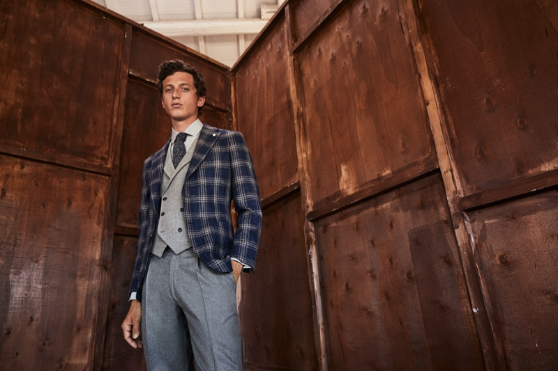Embracing dapper style, Alexis Maçon-Dauxerre wears a fall look from Luigi Bianchi Mantova.