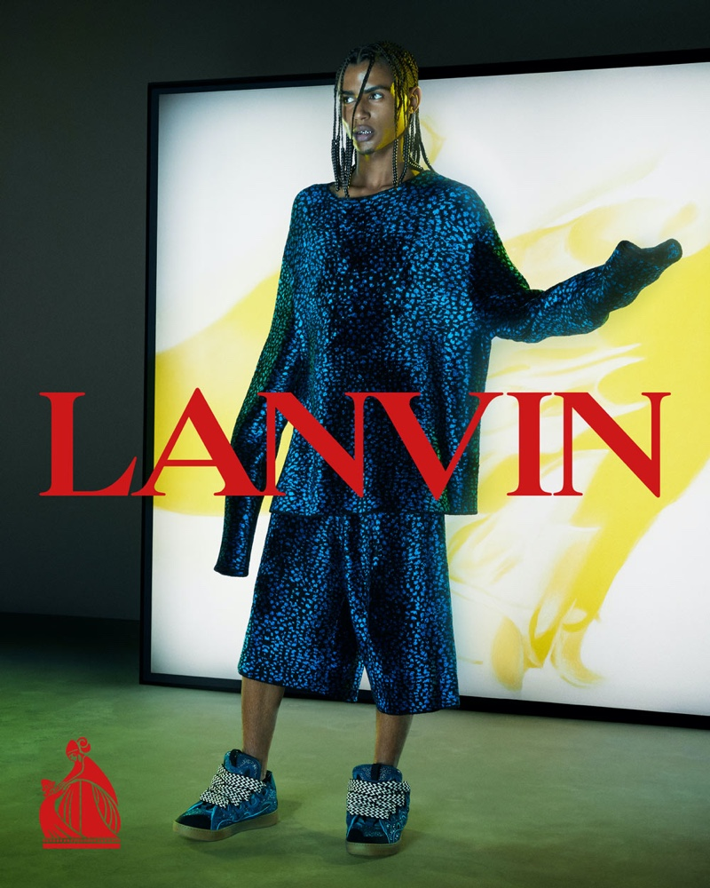 French rapper Luv Resval wears CO-ORD pieces for Lanvin's fall-winter 2021 men's campaign.