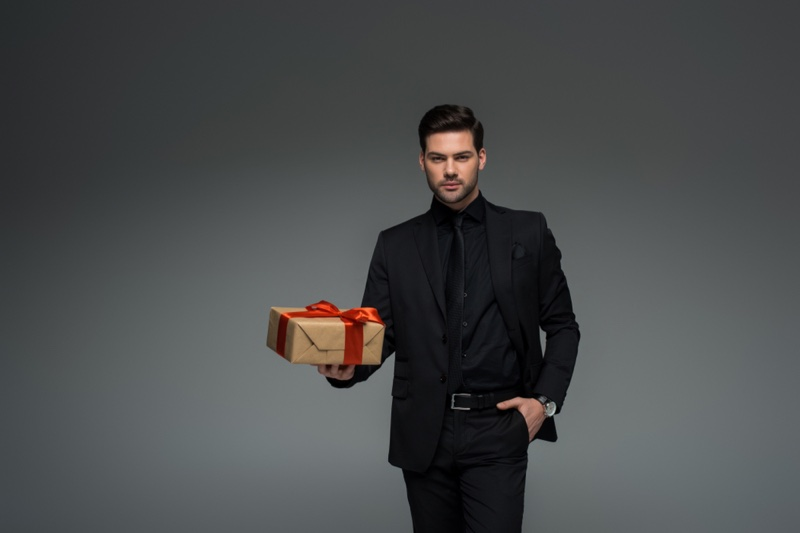 Man Black Suit Holding Gift Box