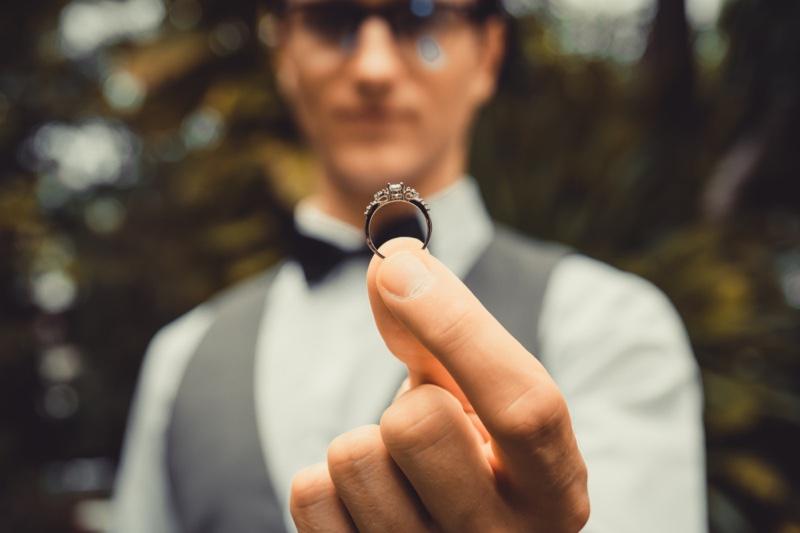 Man Holding Diamond Engagement Ring