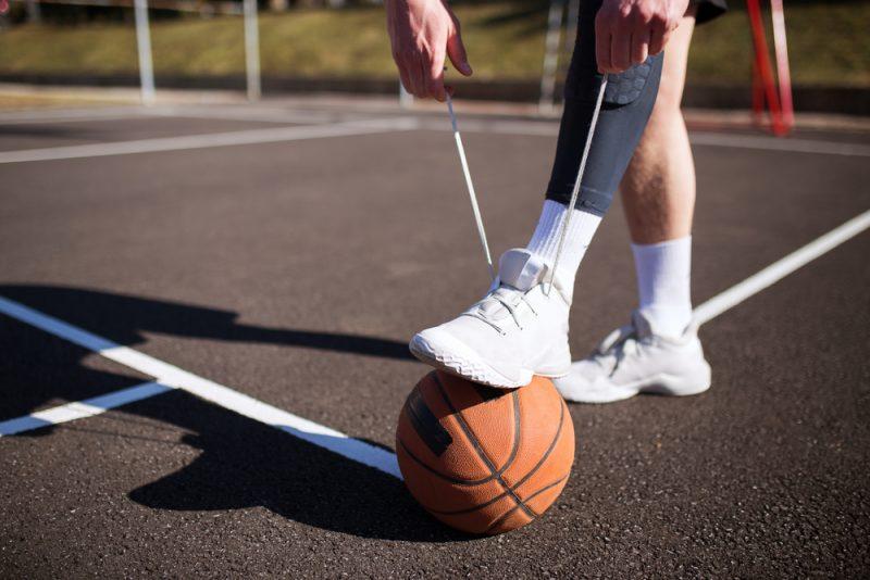 Man Wearing White Basketball Sneakers